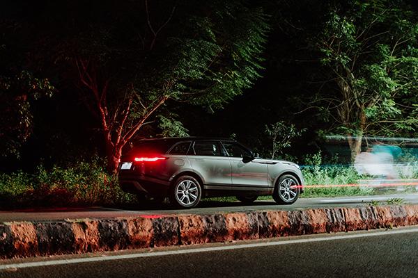 Land Rover driving at night