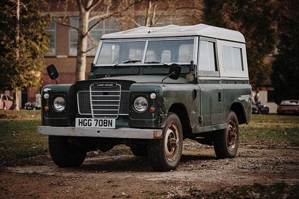 Older green model of Land Rover