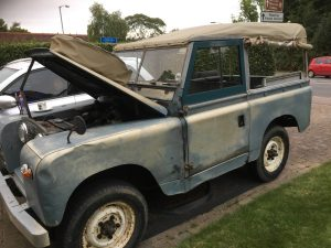 Blue land rover getting its service