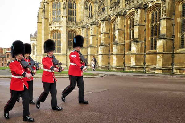 image of the royal family's guards walking